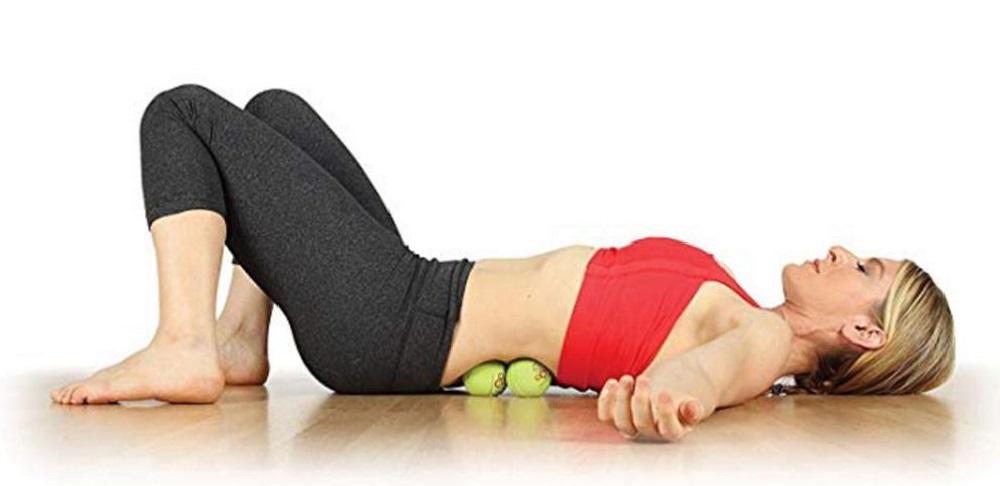 массаж двумя мячиками при защимлении